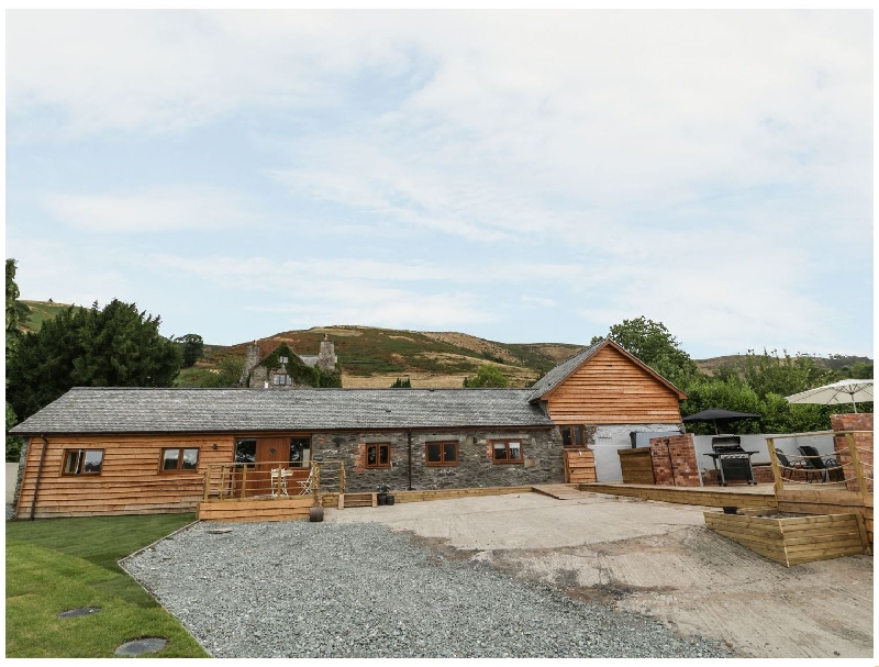 Powys Cottage Holidays - Click here for more about Rhianwen- Plas Moelfre Hall Barns