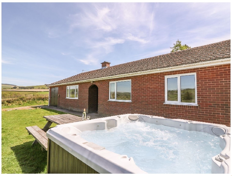 Powys Cottage Holidays - Click here for more about Glanyrafon Bungalow
